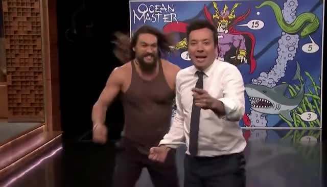 Watch this curated GIF by GIF Machine (@gifmachine) on Gfycat. Discover more aquaman, best, bff, celebrate, excited, fallon, friends, funny, happy, hug, jason, jimmy, lol, love, momoa, stop, strong, throwing, tonight, trident GIFs on Gfycat
