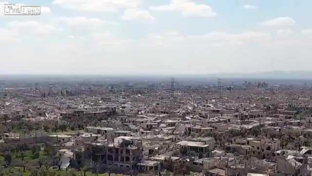 Watch and share Syrian Rocket Strike In A Dense Urban Area GIFs on Gfycat