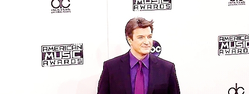 500, also- maximo tv your watermarks are a mess, amas, amas 2014, american music awards, and the floppy hair, gif, he looks so hot, mine, mine: nathan fillion, nathan fillion, nathanfillionedit, red carpet, so dreamy :'), the last one ugh stare into my soul, triple watermark? daeff, Nathan Fillion arrives at the 2014 American Music Awards (x) GIFs