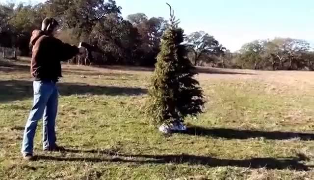 Watch and share AK47 Burns Christmas Tree GIFs on Gfycat