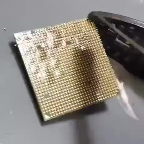Always clean off the yellow pins before installing CPU GIFs