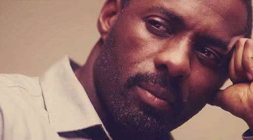 Watch and share Idris Naughty Smile GIFs on Gfycat