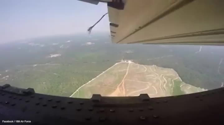 US plane drops a military convoy of Humvee's from 5000 feet. GIFs
