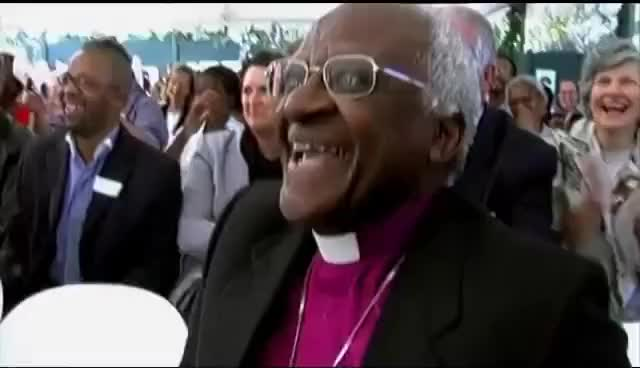 Watch and share Desmond Tutu GIFs and Laughing GIFs on Gfycat