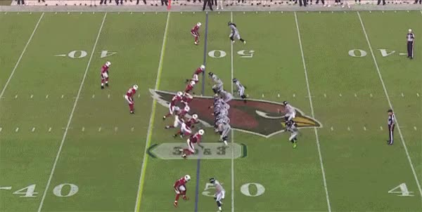 Watch and share Russell Wilson Ridiculous Pass Against The Cardinals GIFs on Gfycat