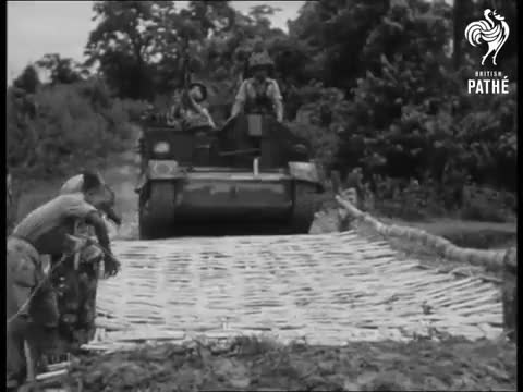 Watch and share Gurkhas In Universal Carriers Move Across A Temporary Bridge. GIFs by realtaylers on Gfycat