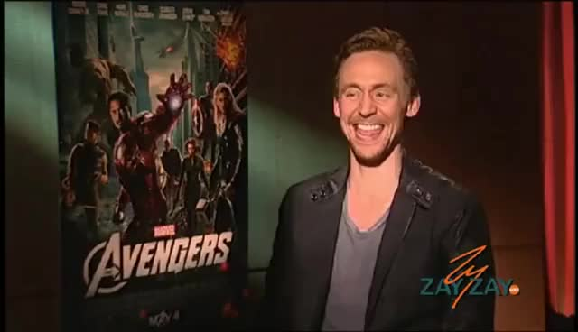 Watch and share Tom Hiddleston GIFs and Laughing GIFs on Gfycat