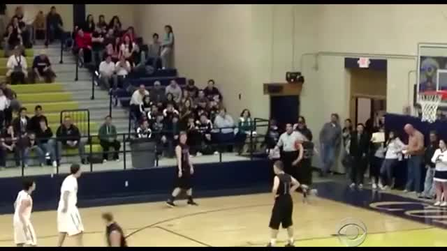 Disabled Basketball Player is Given Help by Opposing Player to Score a Shot