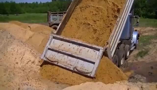 Watch and share GMC Detroit Diesel And International CAT 3406 Dump Trucks Dumping Sand GIFs on Gfycat