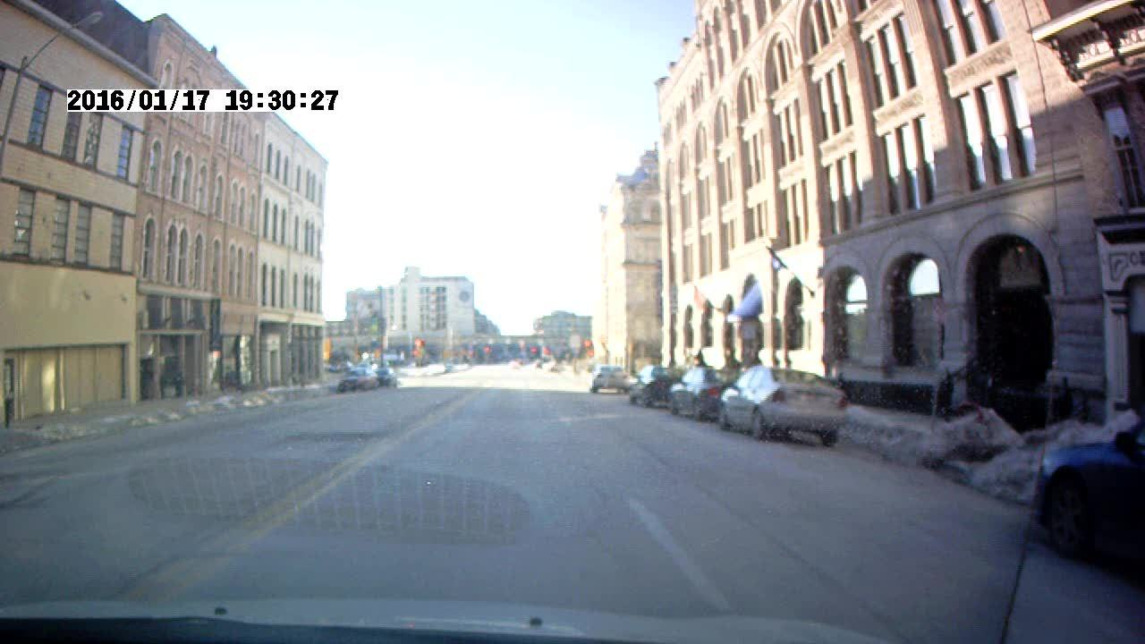 Milwaukee, roadcam, Running a red light while a cop was busy. GIFs