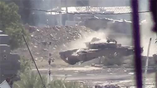 Tank firing a shell [x-post /r/highqualitygifs] : ThingsThatBlowUp GIFs