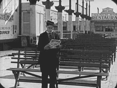 Watch and share Buster Keaton Reading The Newspaper  GIFs by jasonn85 on Gfycat
