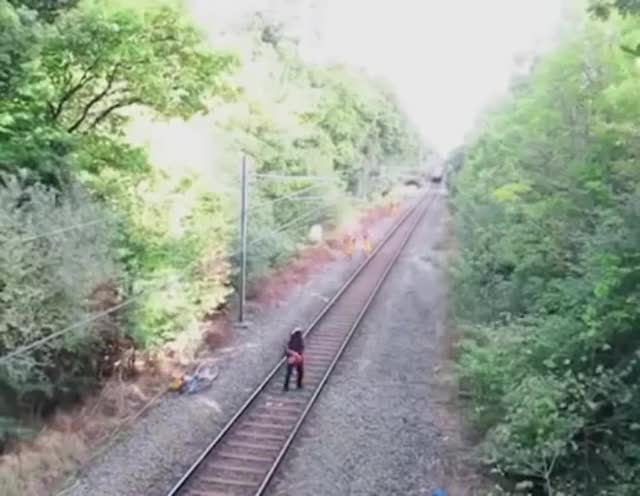 Watch and share Railway Worker Saves An Idiot GIFs on Gfycat
