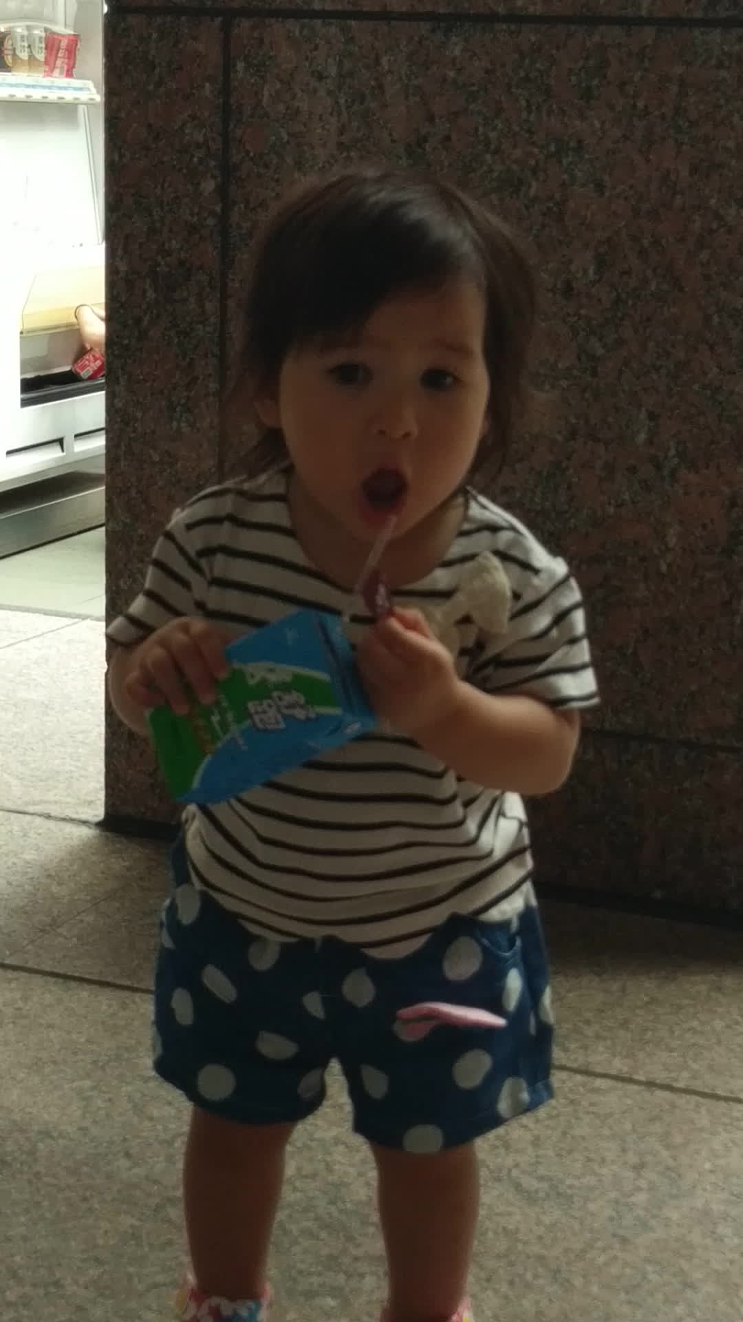 MadeMeSmile, Little girl trying to drink, and keep her sticker. GIFs