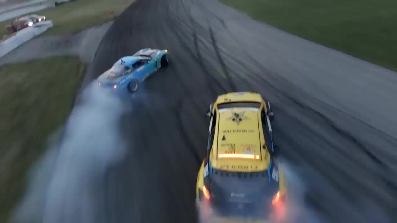 Incredible drone piloting skills while following a drift race GIFs