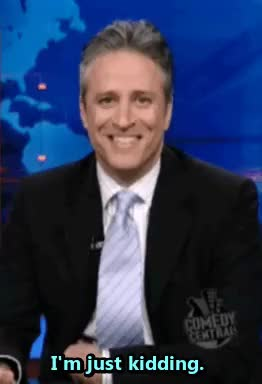 Watch this expressions GIF on Gfycat. Discover more cracking up, expressions, jon stewart, just kidding, reaction gifs, sayings GIFs on Gfycat