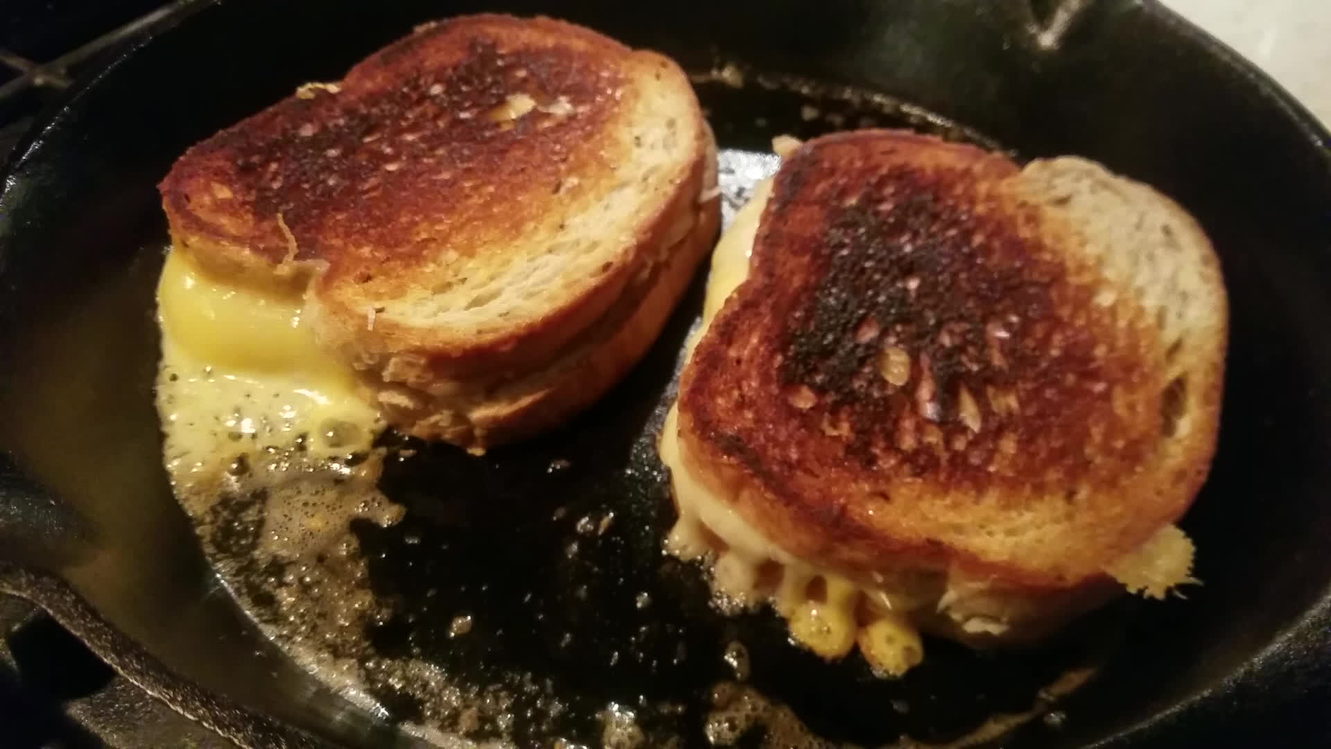 castiron, grilledcheese, Seriosuly sharp cheddar, pecorino romano, and american on rye GIFs