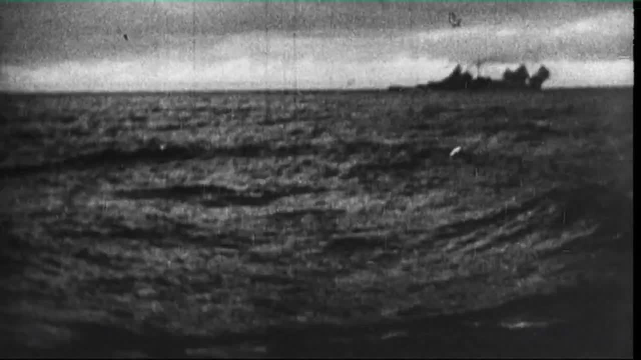 CombatFootage, WarshipPorn, German Battleship Bismarck fires her main batteries at HMS Hood during the Battle of the Denmark Strait. Hood would be sunk, and in return the British would sink the Bismarck. (reddit) GIFs