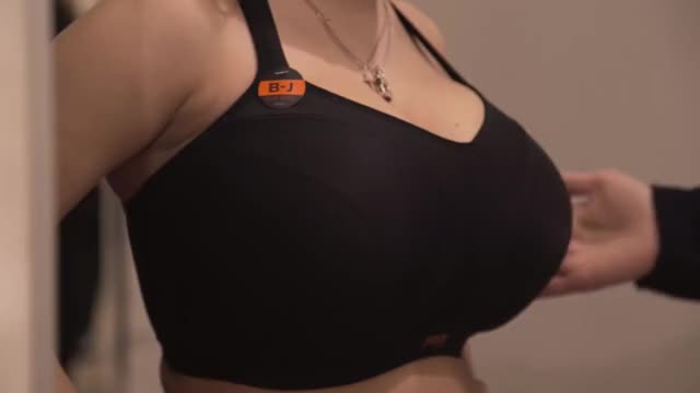 stacy Vandenberg trying on a bra