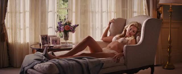 Margot Robbie in sexy lace lingerie and heels seductive in bed showing off her hot body and amazing ass
