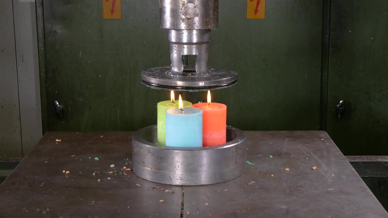 Pressing Candles Through Small Holes with Hydraulic Press - in 4K GIFs