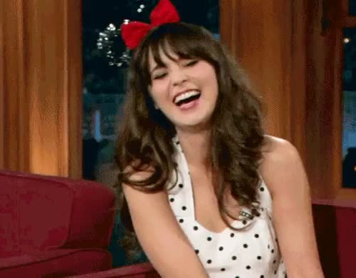 Watch and share Zooey Deschanel GIFs and Laughing GIFs on Gfycat