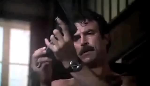 Watch and share Tom Selleck GIFs and Gun GIFs on Gfycat