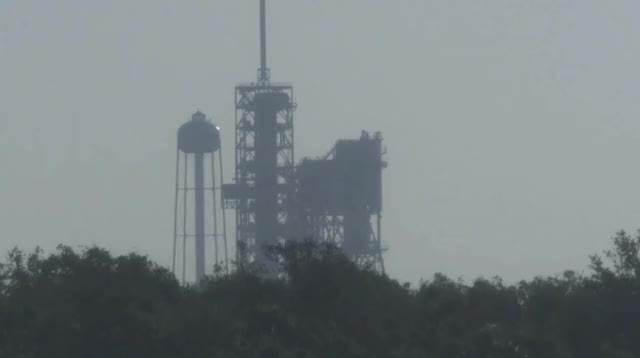 Watch and share Falcon 9 With NROL-76 Hoisted Vertical [@blamedrop] GIFs by blamedrop on Gfycat