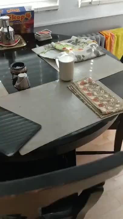 A cup looks like its full of milk But it isnt - gif