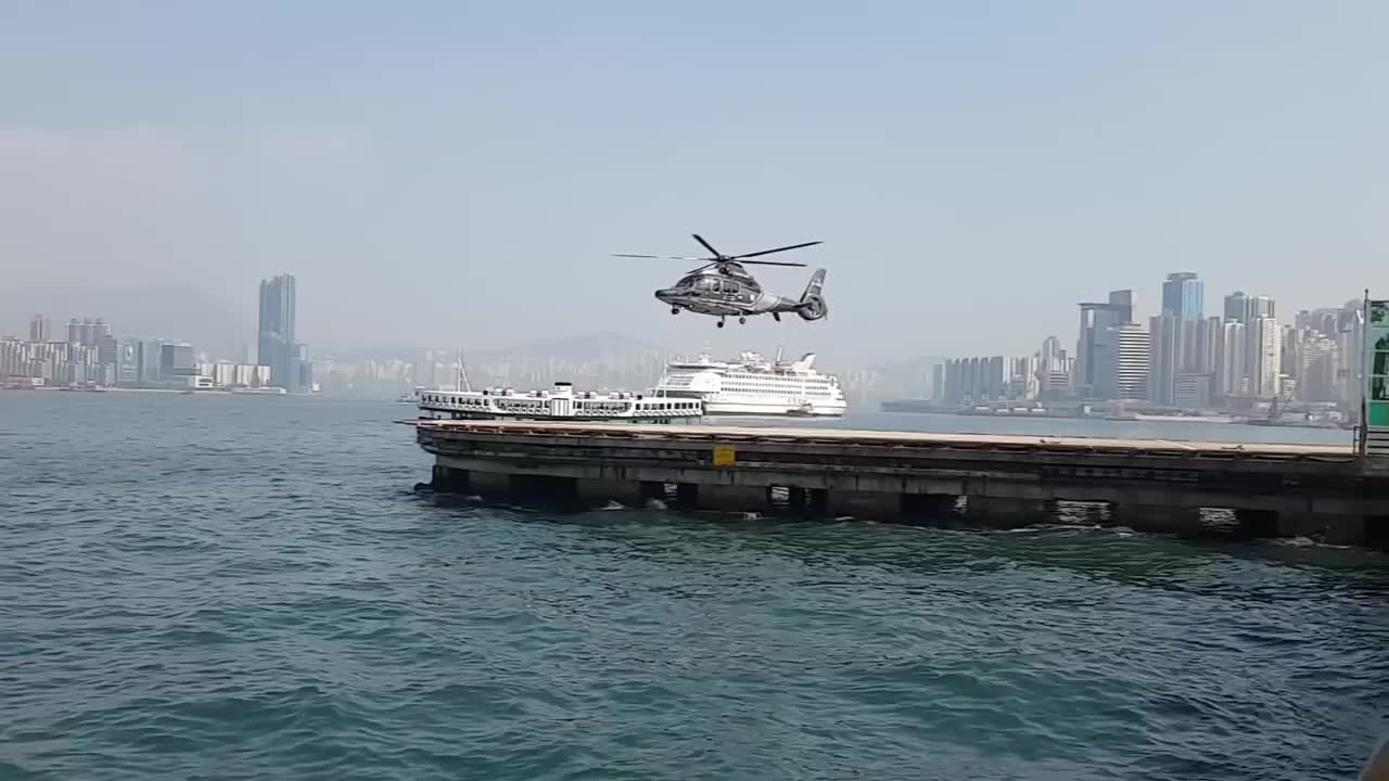 Chris Fay, People & Blogs, helicopter, hongkong, hover, magic, rotor, shutter, speed, camera shutter speed matches helicopter`s rotor GIFs