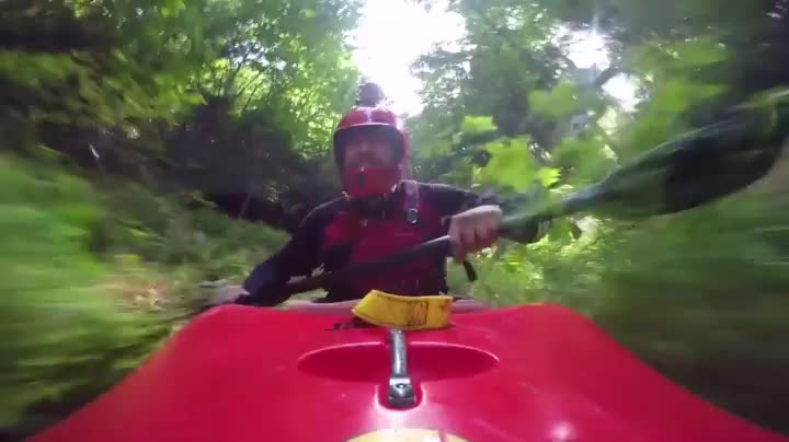 Kayaking down a drainage ditch GIFs