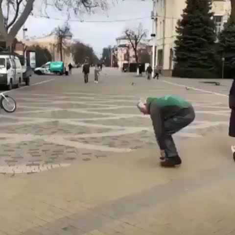 Guy riding the world's smallest bike GIFs
