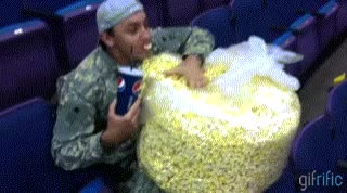 Watch and share Eating Popcorn GIFs on Gfycat