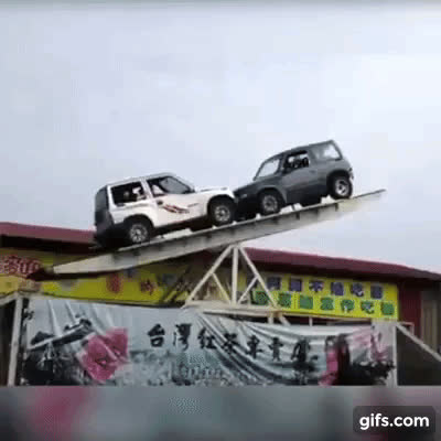 Two 4x4 cars on huge seesaw GIFs