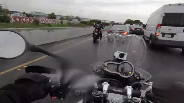 Watch and share Lanesplitting Through Rainy Traffic GIFs by motouser on Gfycat