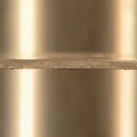 Using friction drilling to make holes in metal GIFs