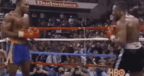 """Watch [GIF] Evander suffered the first knockdown in round 3 from Bert Cooper, but returned with a literal clinic of uppercuts. """"He didn't give up,"""" Holyfield said. """"He didn't take anything for granted. He was aggressive enough to put me in a fight I didn't want to be in."""" This Day In Boxing Nov 23 1991. (reddit) GIF on Gfycat. Discover more boxing GIFs on Gfycat"""