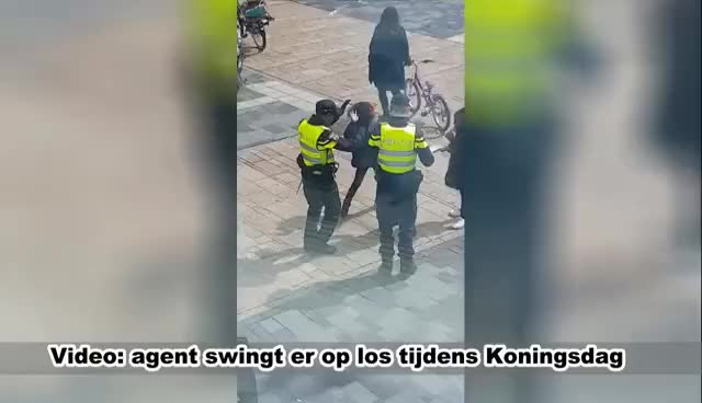Watch and share Dansende Agent Tijdens Koningsdag In Almere GIFs on Gfycat