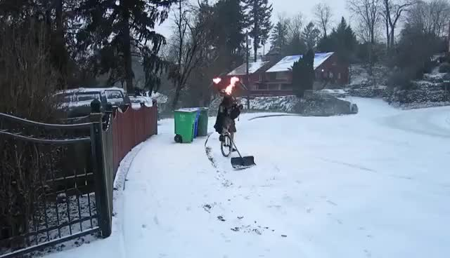 Watch and share Man Shoveling Snow On A Unicycle Dressed As Darth Vader While Playing Flaming Bagpipes GIFs on Gfycat