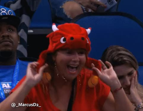 Chicago Bulls fan with Bulls hat is hyped reaction.