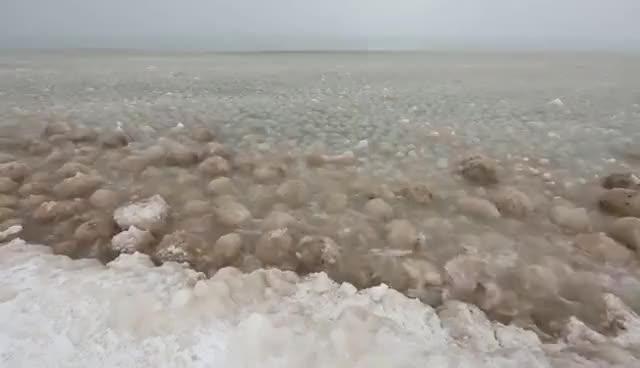 Watch and share Ice Balls Forming Along Lake Michigan Near Glen Arbor GIFs on Gfycat