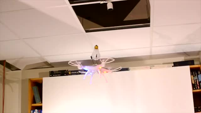 Watch and share Replacing A Lightbulb With A Drone GIFs on Gfycat