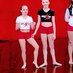 Maddie and Mackenzie Ziegler being silly at pyramid (season