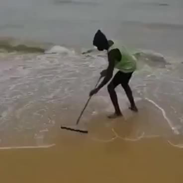 Watch and share Man Sweeping Ocean GIFs on Gfycat