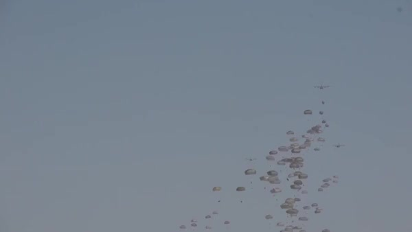 Watch and share Paratroopers Form The 82nd Airborne Division Parachute Onto White Sands Missile Range For The Network Integration Evaluation GIFs by sammy on Gfycat