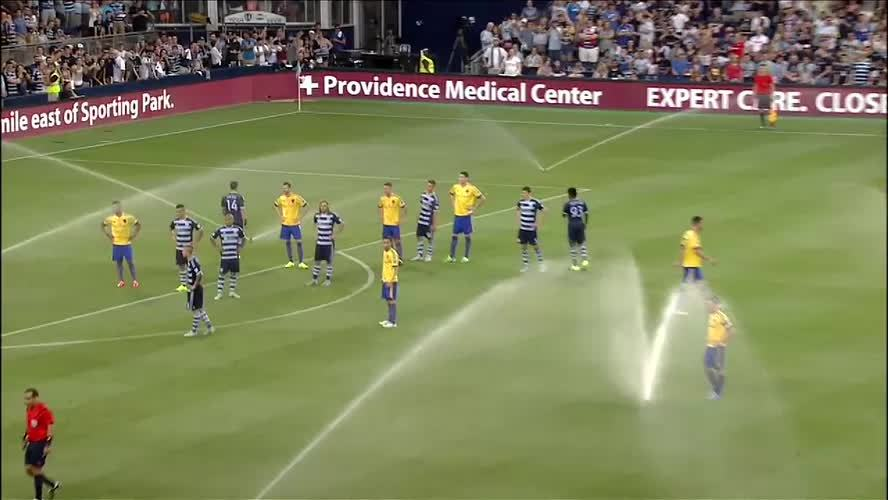 footbaww, sportsarefun, Soccer player sprays another with malfunctioning sprinkler (reddit) GIFs