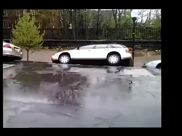 Row of cars slowly toppling away during a landslide  (reddit