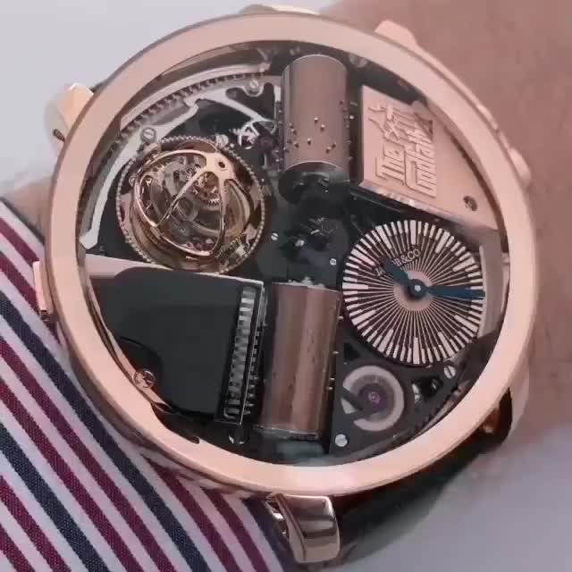 Watch and share Tourbillon Watch Playing The Godfather Theme GIFs by tothetenthpower on Gfycat