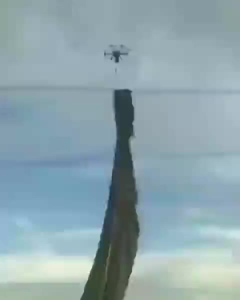 Watch and share Flamethrower Drone Being Used To Remove Debris Hanging Off High Voltage Power Lines GIFs by tothetenthpower on Gfycat
