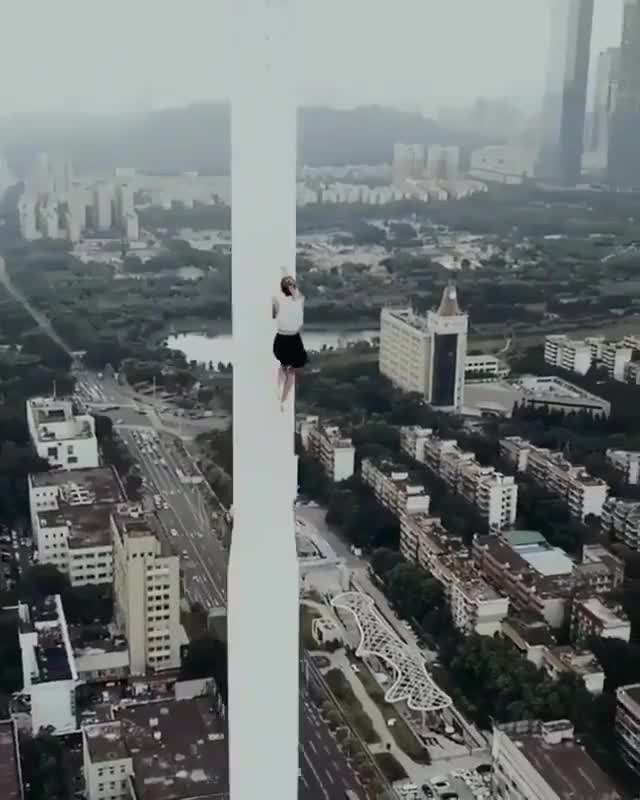 Watch and share Tower Climbing In A Dress GIFs on Gfycat
